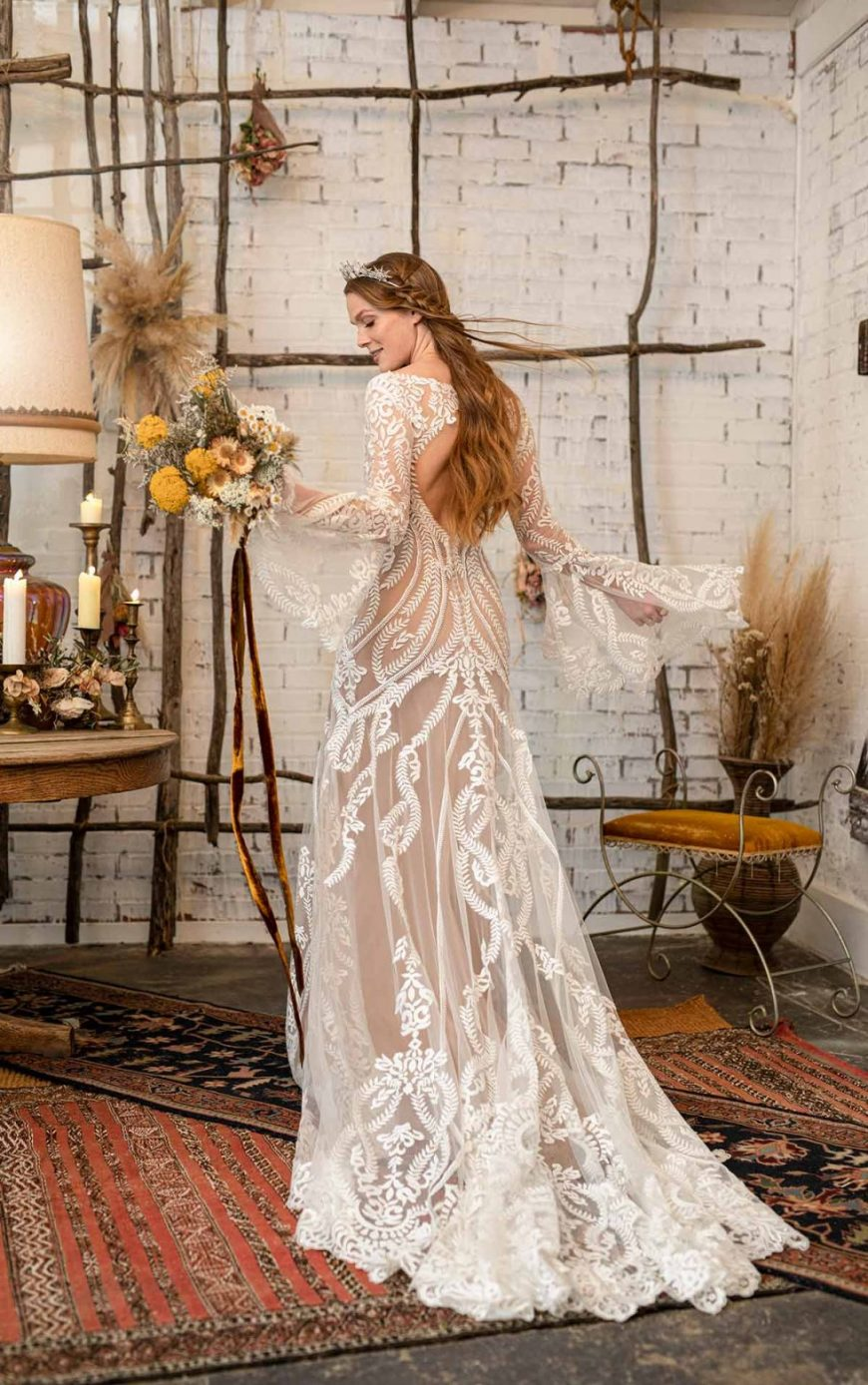 Fit-and-flare Lace Flared sleeves Keyhole back. Lenox All Who Wander Tuscany Bridal